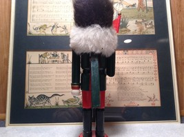 Green Russian Hat Wearing Nutcracker with Flag in Hand Ten and Half Inches Tall image 7