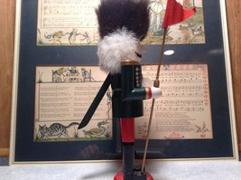 Green Russian Hat Wearing Nutcracker with Flag in Hand Ten and Half Inches Tall image 8