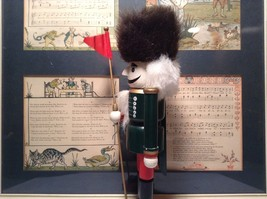 Green Russian Hat Wearing Nutcracker with Flag in Hand Ten and Half Inches Tall image 5
