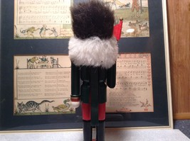 Green Russian Hat Wearing Nutcracker with Flag in Hand Ten and Half Inches Tall image 6