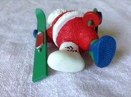 Hallmark Keepsake Ornament Christmas Break Santa has a Cast on Holding a Sled image 5