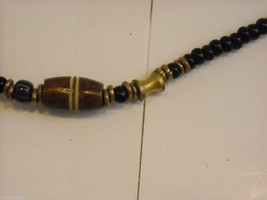 Handcrafted Beaded Necklace with Tribal Wood Carving Metalwork by Kenyan Artist image 6