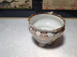 Porcelain White Tea Cup with Gold Tone Accents Intricate Rim and Handle image 3