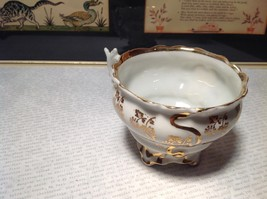 Porcelain White Tea Cup with Gold Tone Accents Intricate Rim and Handle image 4