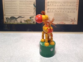 Small Childrens Wooden Yellow Cow String Toy on Green Base Push Bottom Action image 5