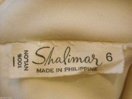 Vintage pair of White Hand Stitched Elbow Gloves by Shalimar image 4