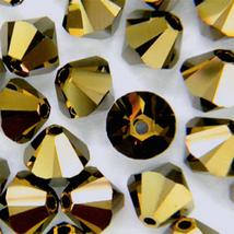 4mm Crystal Dorado 2X Swarovski Xilion Beads 5328 ( 72 )  bronze bicone - $7.25