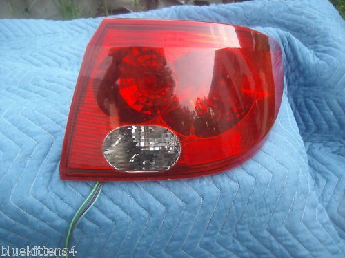 Primary image for 2003 SATURN L  200 300  RIGHT TAILLGHT OEM 4 DOOR SEDAN