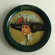 "Vintage Coca Cola Tin Lady with Big Hat  3.5"" Diameter - $5.69"