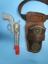 Vintage 1960's Daisy Bullseye cap gun with leather holster - $49.49