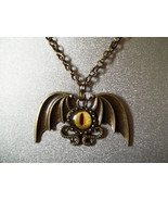 Antique Bronze Dragon wings and eye Necklace - $25.00