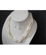 Ivory Faux triple strand twisted Necklace and earring set - $35.00