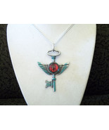 Winged Key with red eye - $20.00