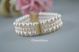 Bridal bracelet, wedding jewelry, Ivory pearls, three strands - $38.50