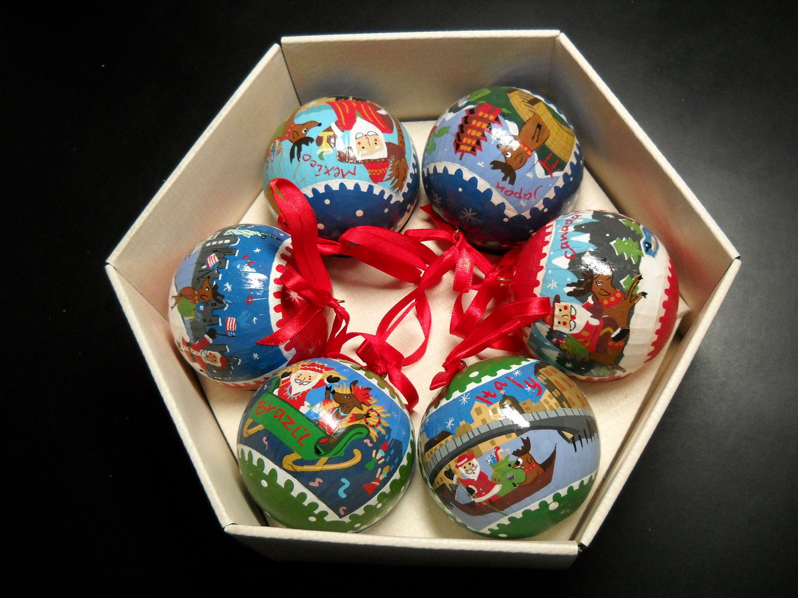 Primary image for Pottery Barn Christmas Ornament Set of Six Santa Around The World Paper Ribbons