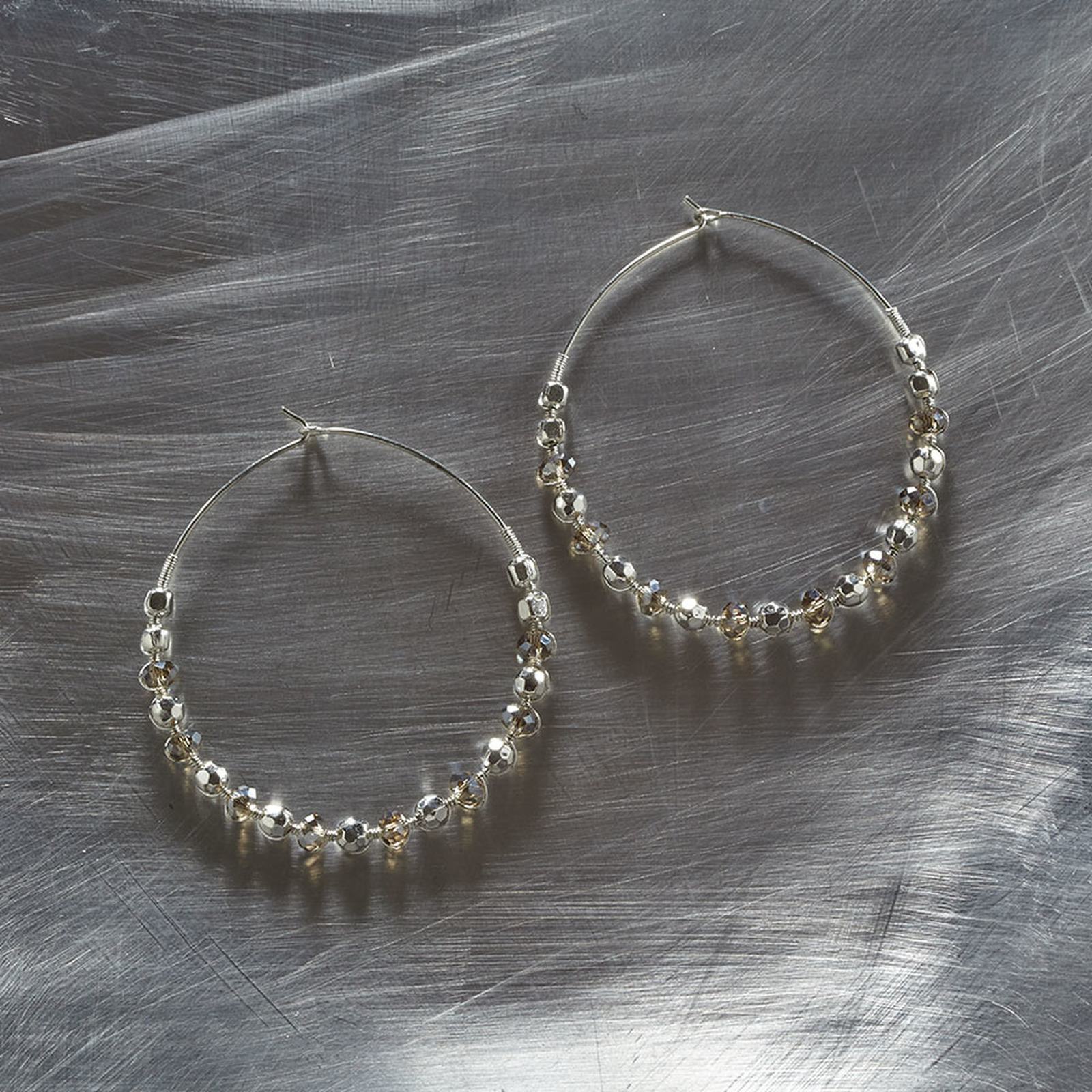 Faceted silver bead hoop earrings