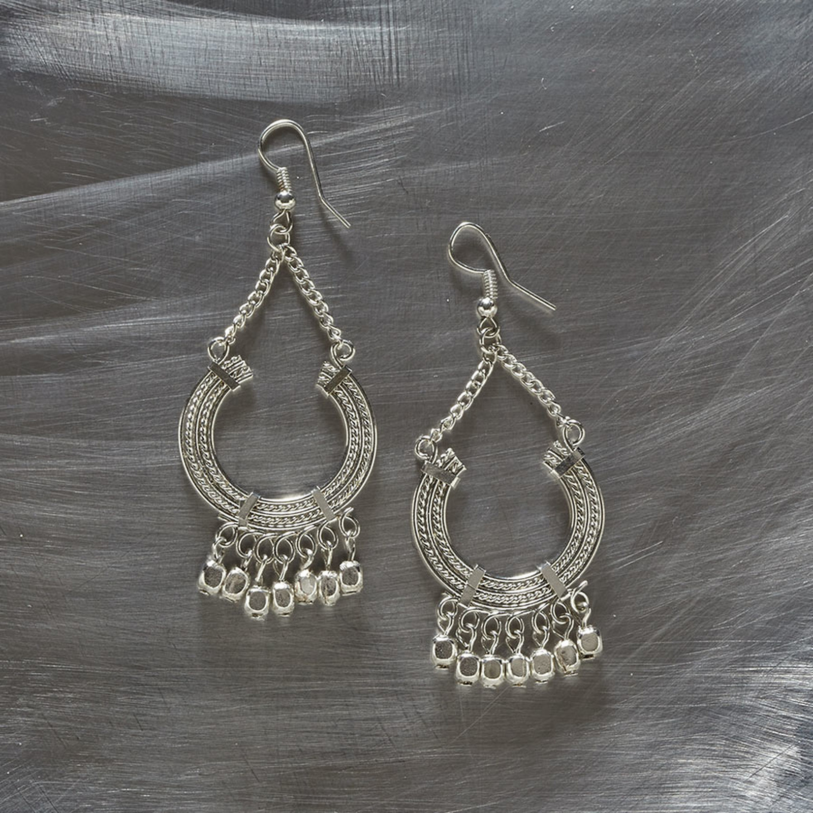 Unique global inspired silver U shaped earrings