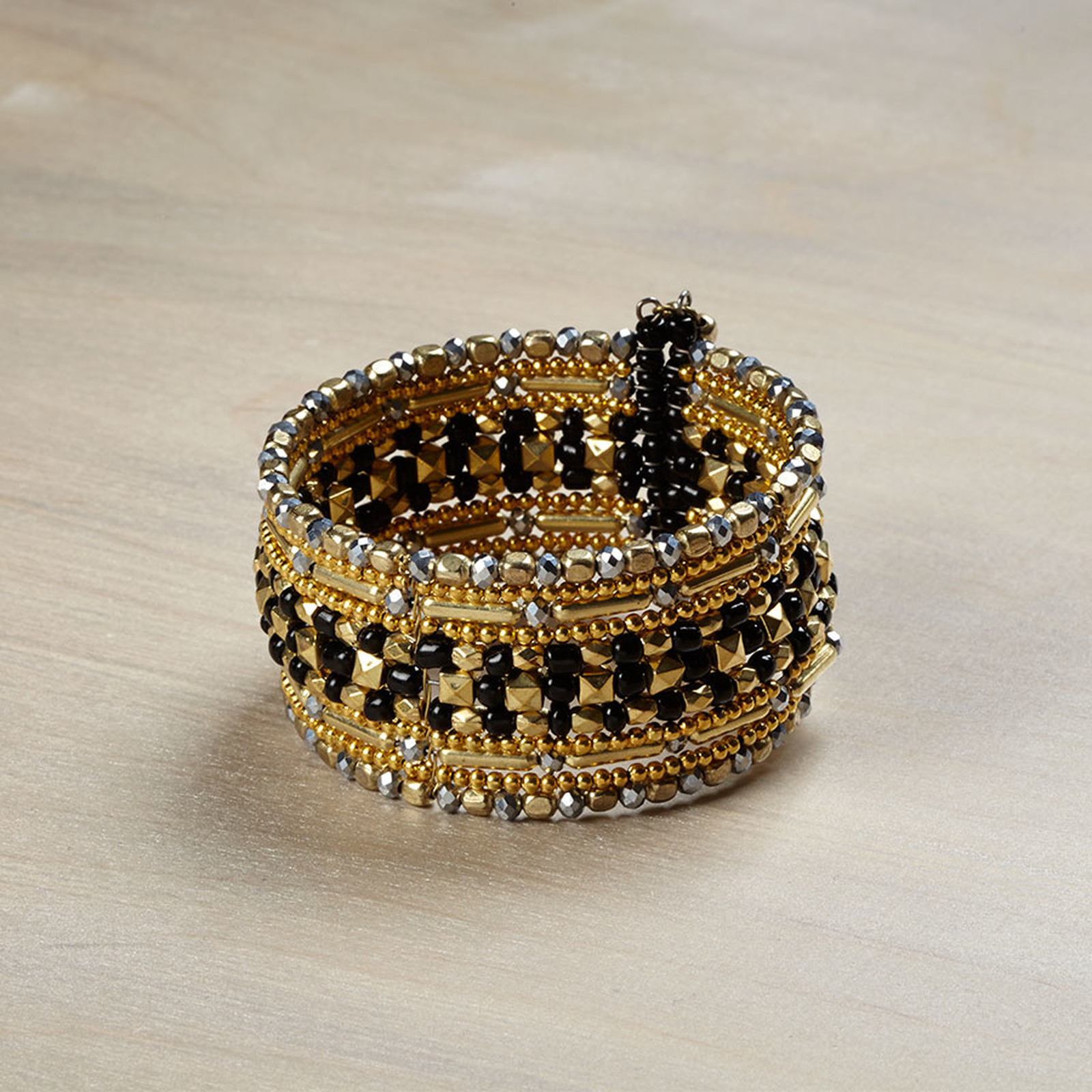 Gold and hematite black statement fashion bracelet w seed beads