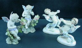 4 Vintage Lefton Angels with Flowers or Birds Figurines - $29.69