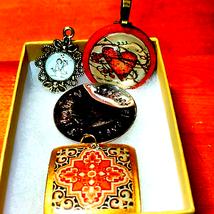 Four beautiful vintage pendants - $19.80