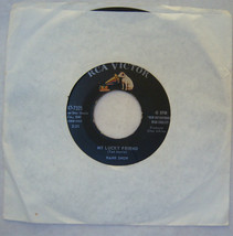 A Woman Captured Me/My Lucky Friend by Hank Snow RCA Victor Records 45RPM - $1.99