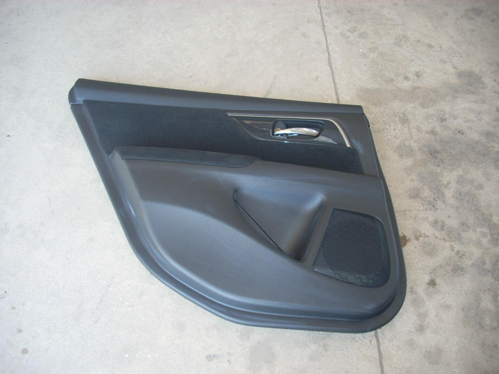 1869  left rear door trim panel 1869
