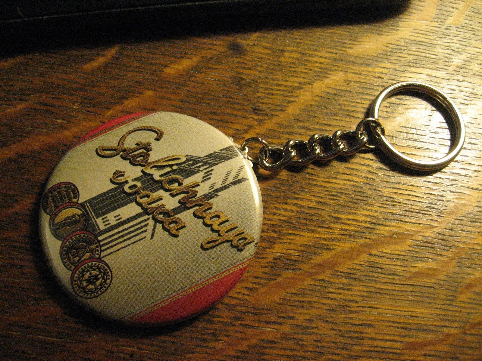 Stolichnaya Vodka Keychain - Repurposed Magazine Backpack Purse Clip Ornament