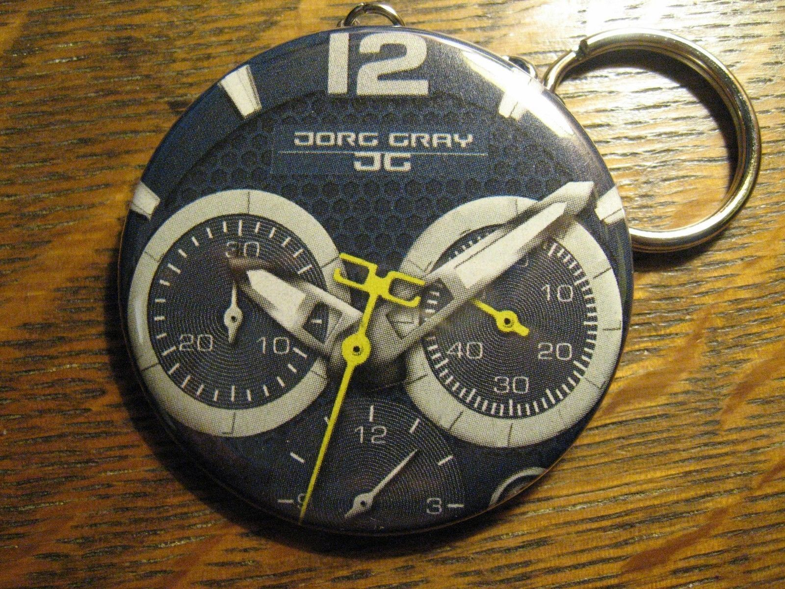 Jorg Gray Watch Keychain - Repurposed Advertisement Backpack Purse Clip Ornament