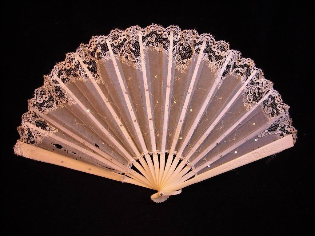 Early 20th Century white lacey graduation fan w carving vintage