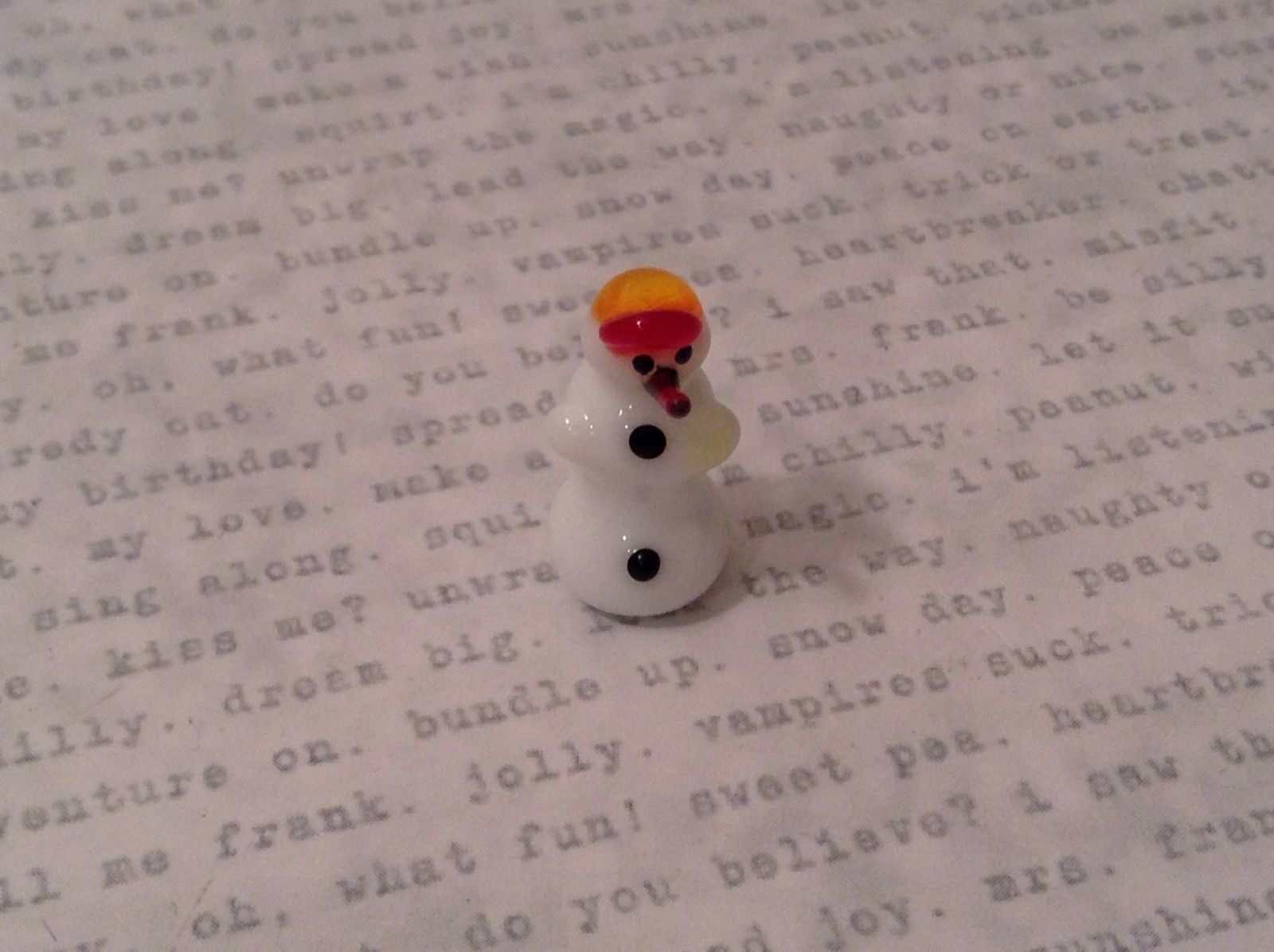 Micro miniature handblown glass figure snowman w yellow red baseball cap USA NIB