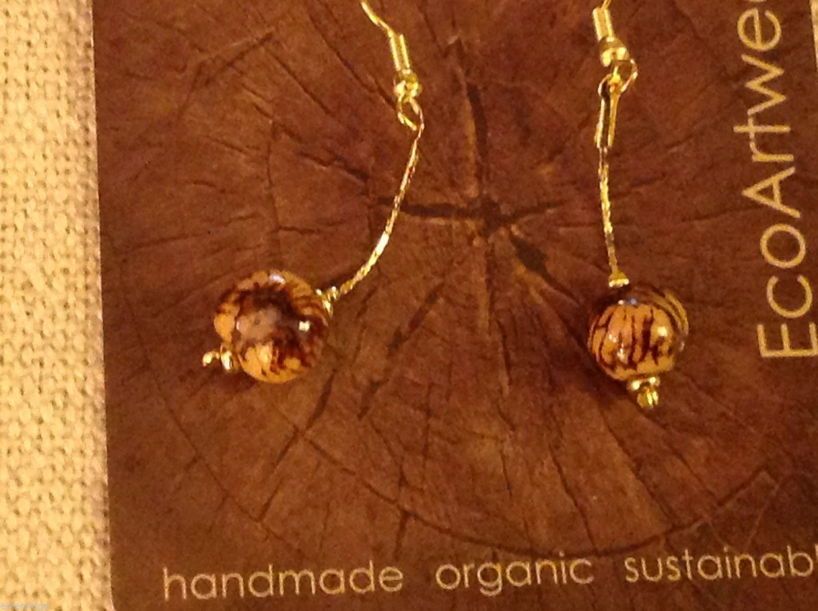 Shade choice of acai berry seed earrings by Terra help sustain amazon rainforest