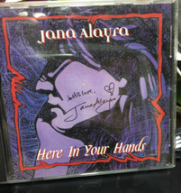 HERE IN YOUR HANDS SIGNED BY JANA ALAYRA - $18.58