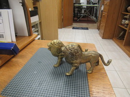 "PAIR OF SOLID BRASS LIONS   7"" LONG   4"" HIGH     - $37.50"