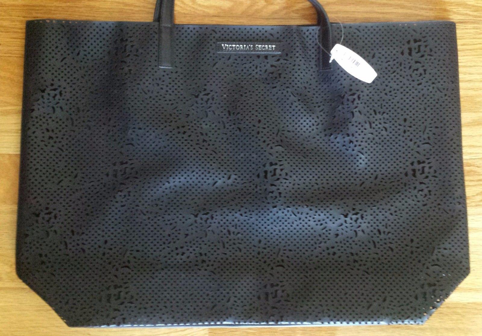 NWT Victoria's Secret Black Lazer-cut Beauty Tote Bag. See through front.