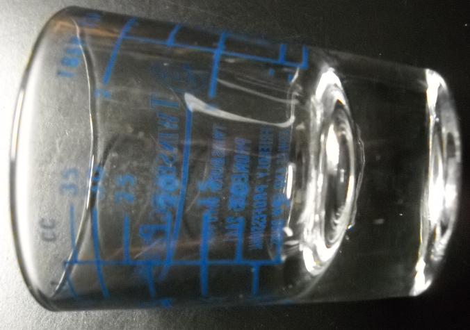 Twinsburg Pharmacy Shot Glass Clear Glass with Blue Print and Level Markings