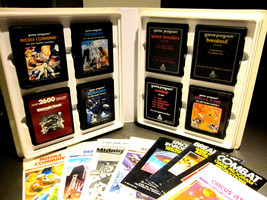 Atari 2600 Game Lot of (8) with Manuals in Original 1981 Storage Binder Lot #01 - $35.00