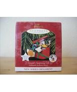 1997 Hallmark Keepsake Ornament Disney Donald's Surprising Gift  - $30.00