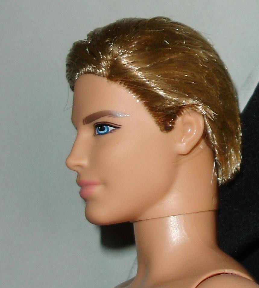 Nude blond Ken doll rooted hair monogrammed underwear and one bent arm left
