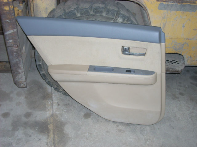 2009 NISSAN SENTRA LEFT REAR DOOR TRIM PANEL