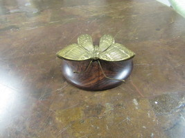 "BRASS BUTERFLY MOUNTED ON WOOD BASE     3 ½"" ROUND     - $14.00"