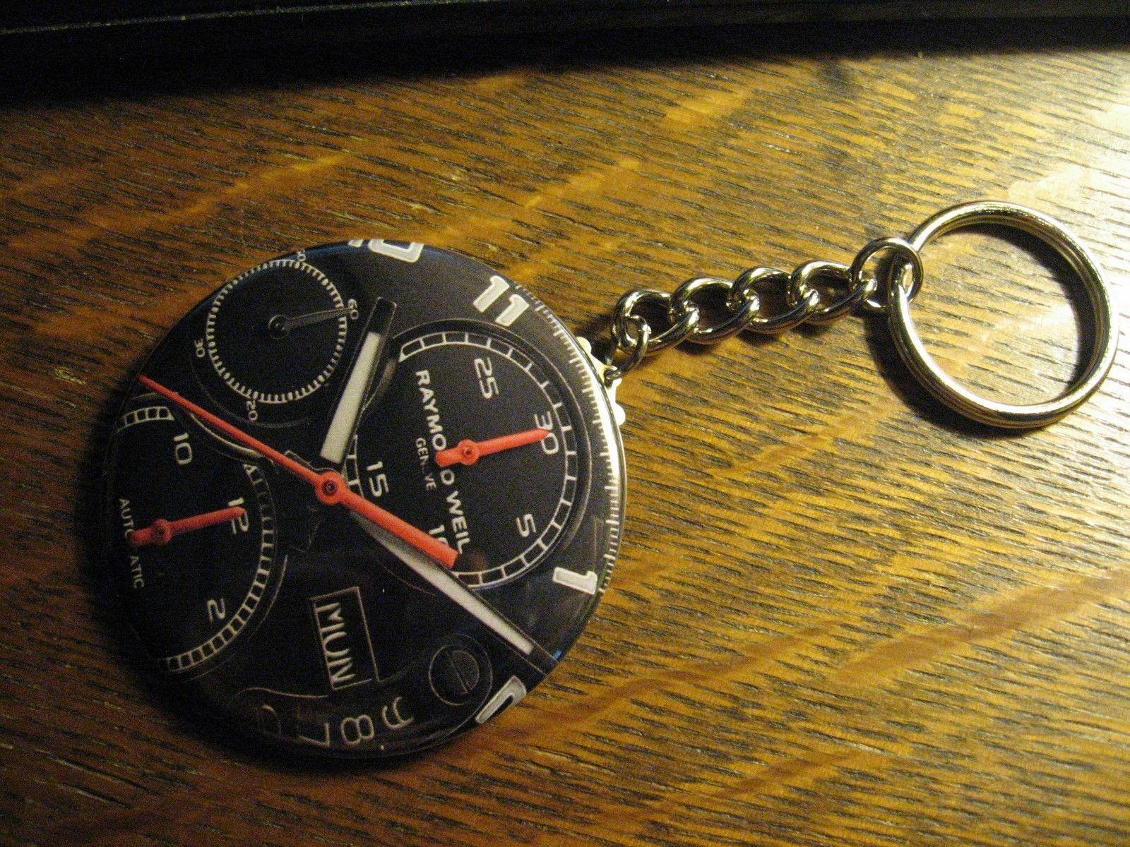 Raymond Weil Keychain - Repurposed Magazine Ad Logo Backpack Purse Clip Ornament
