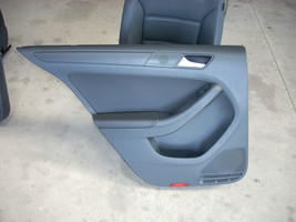2011 VW JETTA LEFT REAR DOOR TRIM PANEL