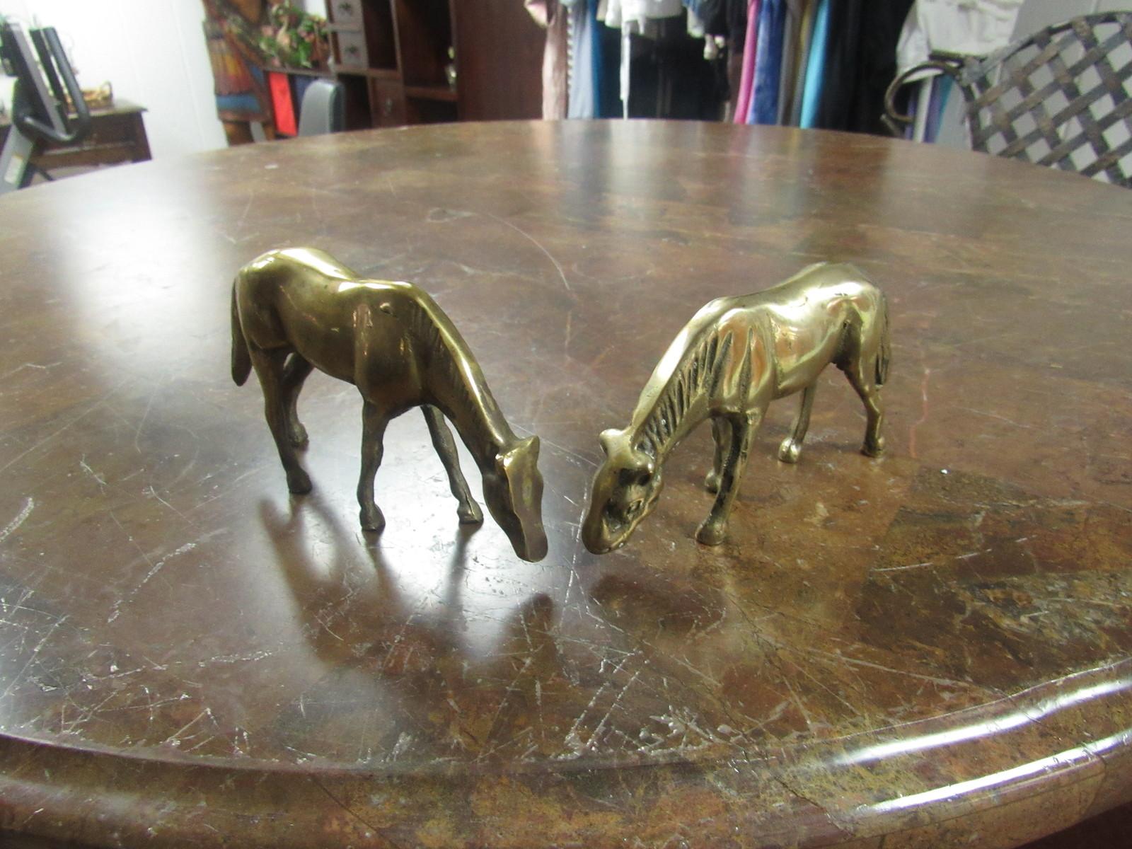 "PAIR OF BRASS HORSES  5"" LONG   3 ¼"" HIGH"