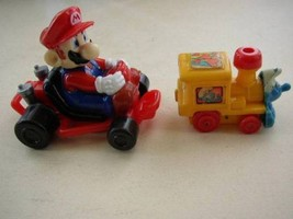 Collectible Lot of 2 Nintendo Mario Figure and Wind-up Smurf - $5.65