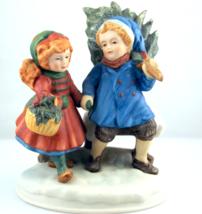 Avon Christmas Memories series Sharing the Christmas Spirit figurine  - $20.00