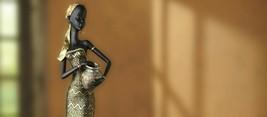 statue of a women - $340.00