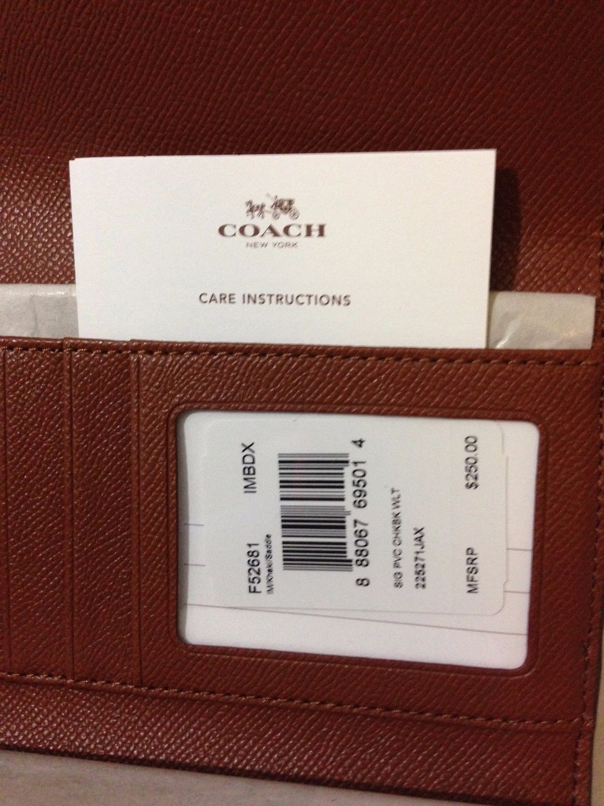 NWT Coach Signature PVC Checkbook Wallet F52681 IM/Khaki/Saddle MSRP $250
