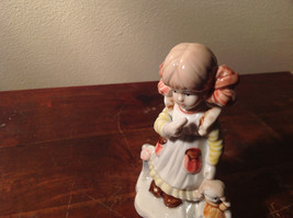 Hand Painted Glossy Ceramic Girl Holding Doll Figurine 5 Inches High