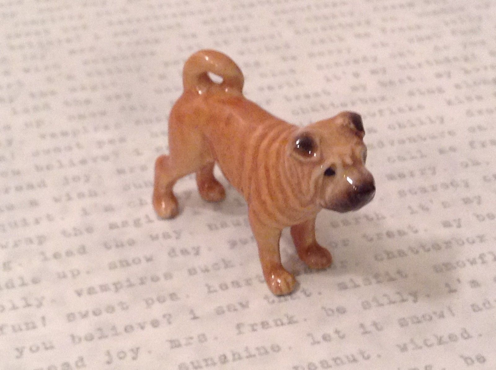 Miniature ceramic Sharpei standing, considering its options