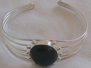 Black and  red spots on a bangle